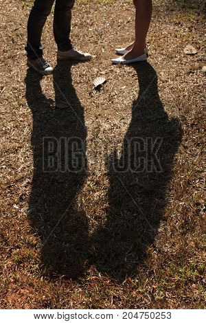 The shadows of two people kissing - stock image