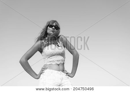 Girl In Sunglasses Relaxing Outdoor Against Sky