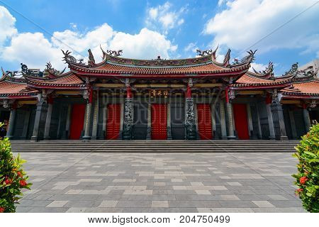 TAIPEI, TAIWAN - August 5, 2017 - Entrance to Xingtian Gong, a traditional Chinese temple devoted to Guan Yu, the patron god of businessmen