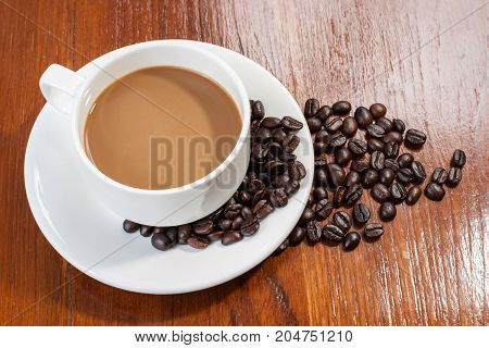 hot coffee on wood table and coffee bean.