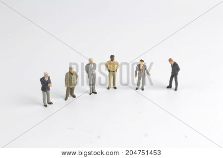 Mini Model Group Of Investor Standing Together