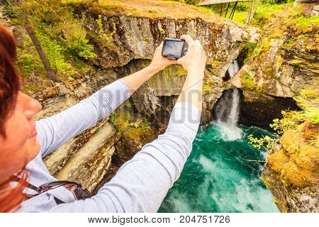 Tourist With Camera On Gudbrandsjuvet Waterfall, Norway