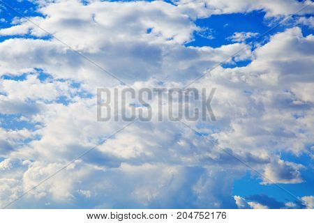 Blue Sky with beautiful tiny clouds .
