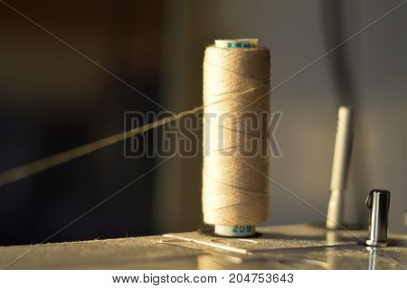 still life of spools of thread on sewing machine