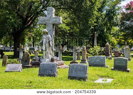Statues, crosses and tombstones in a cemetery.