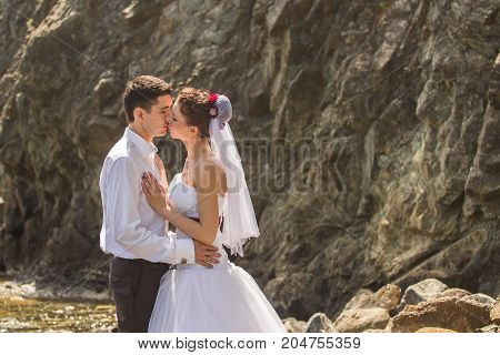 Romantic dating. Young loving couple walking together by the beach enjoying sea.
