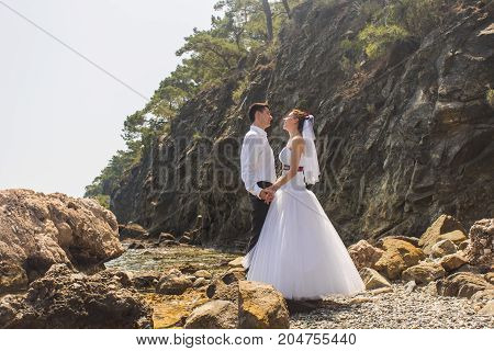 Young loving couple kissing on the beach