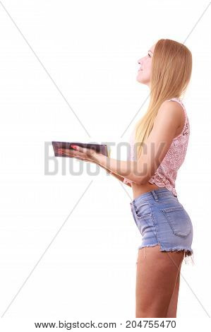 Fascinated woman holding opened book looking for inspiration. White background with copy space.