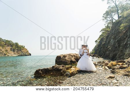 beautiful gorgeous bride and stylish groom on a beach.