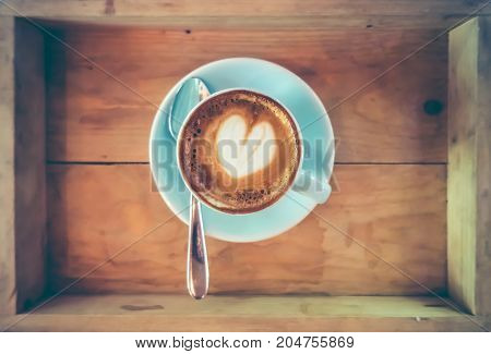 Top View Cup Of Hot Coffee Art On Saucer With Spoon.