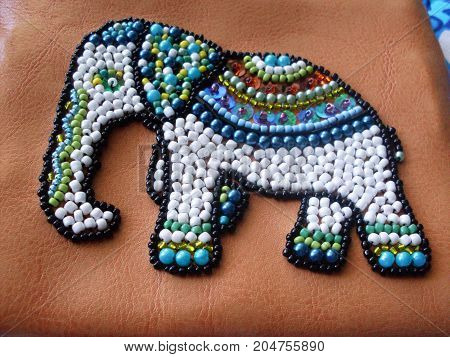 etnic elefant of beads. Embroidery on fabric