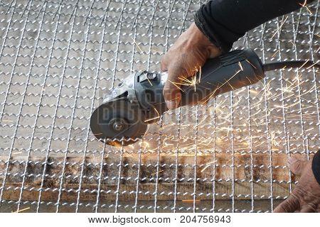 worker used cutting machine to cut iron mesh