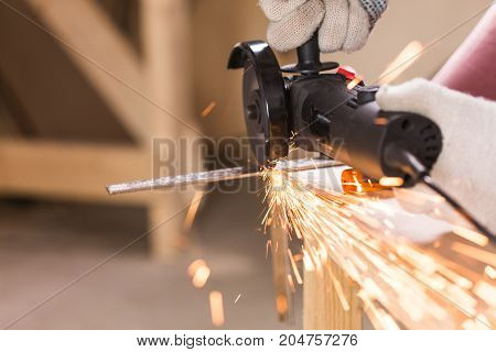 cutting metal with angle grinder, sparks from the disk