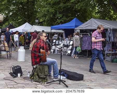 TURKU, FINLAND ON JUNE 30. Performance, street busker, song and music during the Medieval Market and Festival on June 30, 2017 in Turku, Finland. Unidentified people in the street. Editorial use.