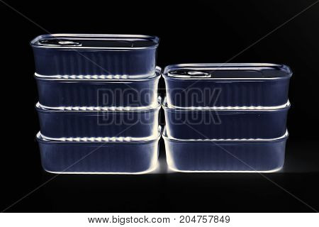 close up food tin can on the black background
