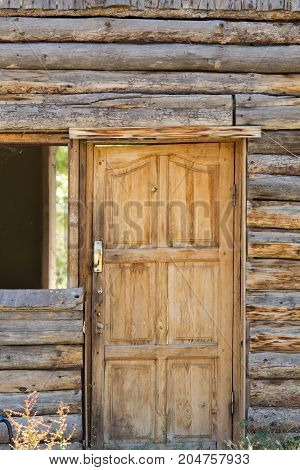 wooden door in a house with log