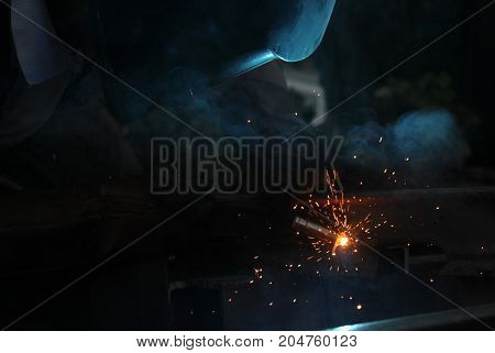 Welding Work.sparks And Smoke Of A Welding Work