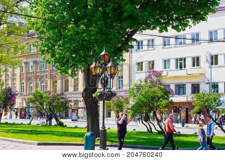 Lviv, Ukraine - May 6, 2017: The people going at Central square in Lviv, Ukraine on May 6, 2017
