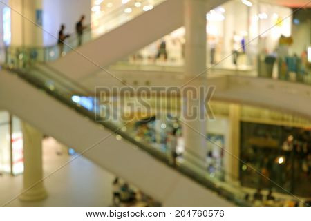 Abstract blurred of people on the escalator going up in the shopping mall