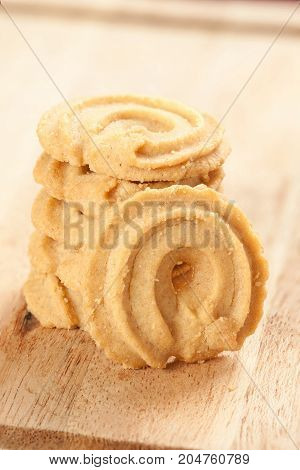 Round shaped cookie on wood pan - stock image