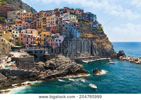 View of the colorful houses of ancient city of Manarola and the coast Italy. Cinque Terre National Park Ligurian Riviera UNESCO World Heritage Site. Tourist sight. View from trails of love