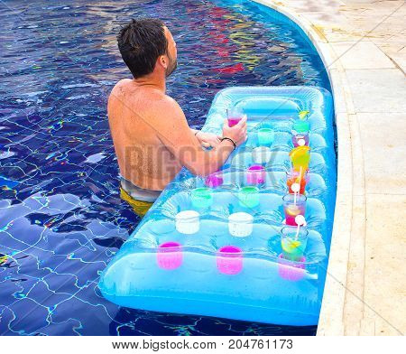 Sharm el Sheikh -April 12, 2017: Tourist enjoying cocktail in a swimming pool at Sharm el Sheikh on April 12, 2017