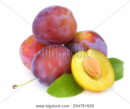Fresh Plum Fruit With Cut Plum Slices Isolated On White Background