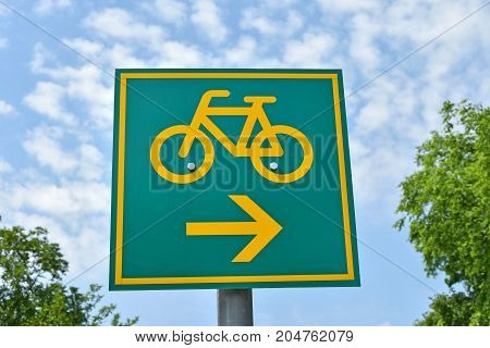 Bicycle road sign on the street in the city