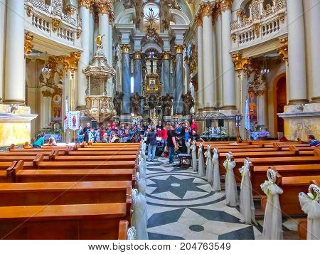 Lviv, Ukraine - May 6, 2017: The people at Dominican cathedral, one of the most beautiful cathedrals in Lviv on May 6, 2017