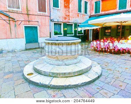 Venice, Italy - May 04, 2017: The empty street with cafe in Venice, Italy on rainy day on May 04, 2017