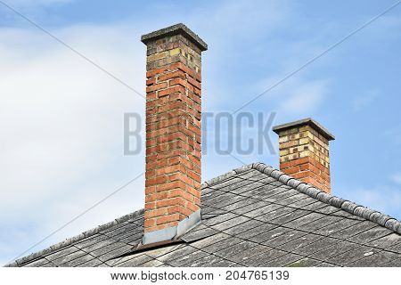 Smoke stacks on the roof of a building