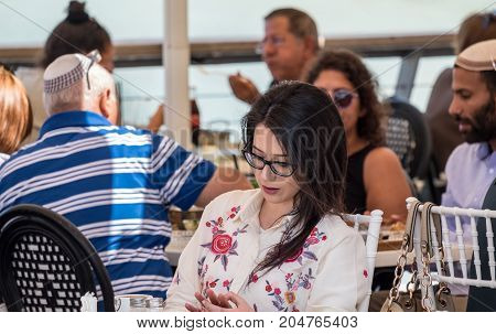 Undefined Religious Jewish Woman Sit In Cafe At Tel-aviv Promenade