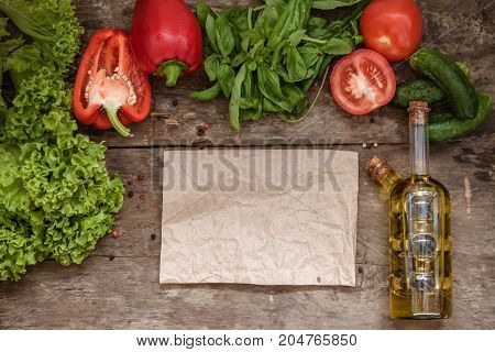Raw Ingredients Of Salad, Tomato, Cucumber, Pepper, Olive Oil On A Wooden Background, Top View And B
