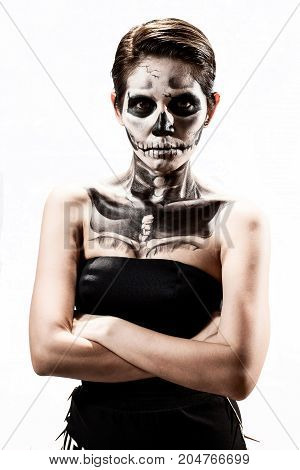 Women painted as skeleton - Halloween theme.