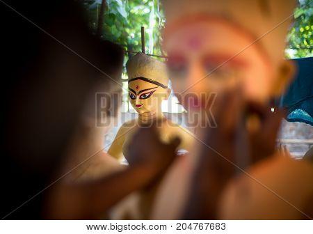 New Delhi, India -  17 September 2017: A Worker Making Clay Idol Of Goddess Durga, Under Preparation