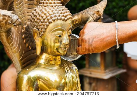 Thai culture - watering the Buddha image on New Year's Day of Thailand