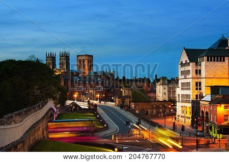 York, UK. Sundown of central York, UK, with York Minster cathedral on the back and blue cloudy sky.