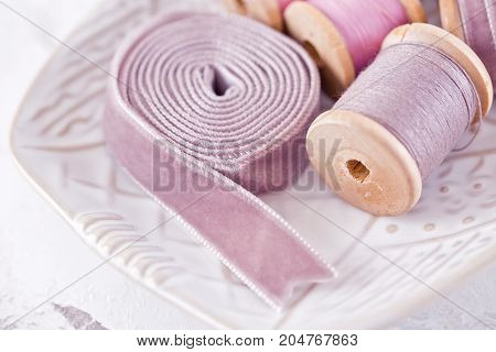 Bowl with pool of threads on pink gray color over marble table background. Mockup. Flat lay top view