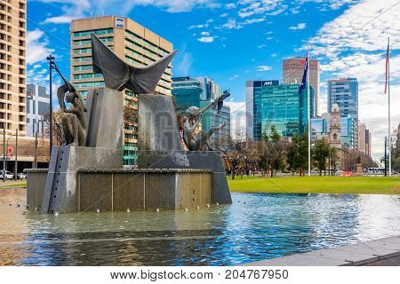 Adelaide Australia - June 28 2017: Victoria Square fountain viewed from South to North with office buildings at morning time