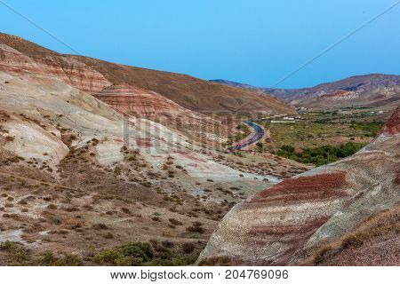 Amazingly beautiful red striped mountains landscape, sunset time