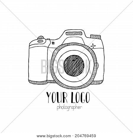 Sketch of a retro photo camera drawn by hand on a white background