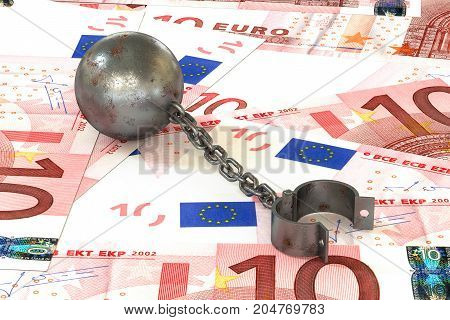 3d illustration: rusty iron ball and chain connected to open cuff lying on euros banknotes background. The business concept of debt with a high interest rate. The stress of mortgage. Bribery crime.
