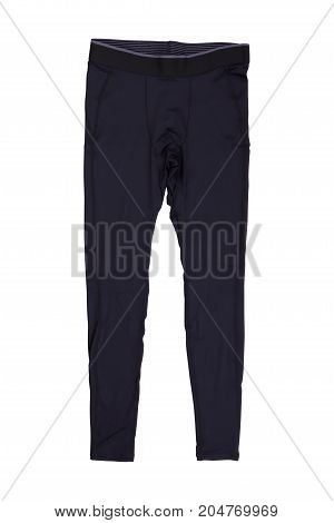 Black tight running pants on wooden background