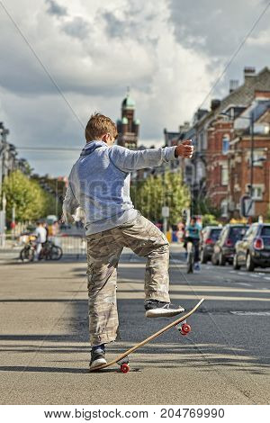 Young Teenager Boy Practice Skateboarding During The Car Free Streets Day