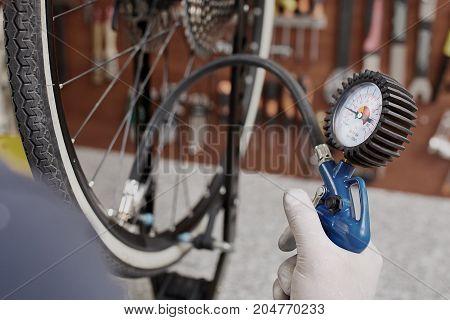 Hands of Mechanic repairing a mountain bike in a workshop
