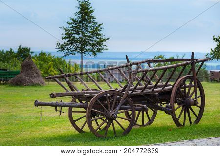 Rustic wooden wagon. Historical conveyance. Historic vehicle.