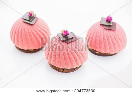 Pink cupcake background on white. strawberry dessert decorated chocolate
