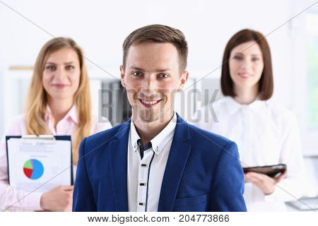 Group Of Smiling People Stand In Office