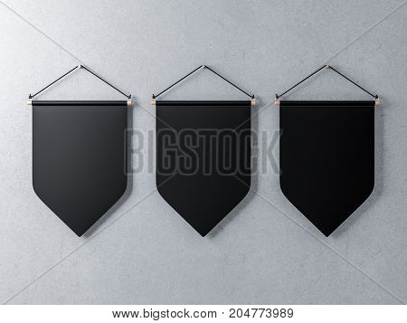 Three Black pennants hanging on a concrete wall, 3d rendering