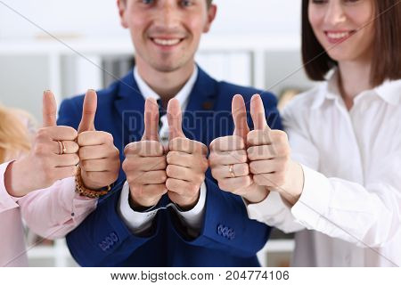 Group Of People Show Ok Or Approval With Thumb Up